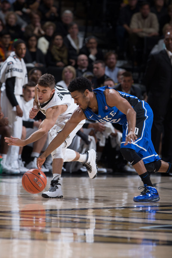 "Wake Forest's Mitchell Wilbekin in the Air Jordan 10 ""Steel"" and Duke's Quinn Cook in a Nike LeBron X iD, respectively"