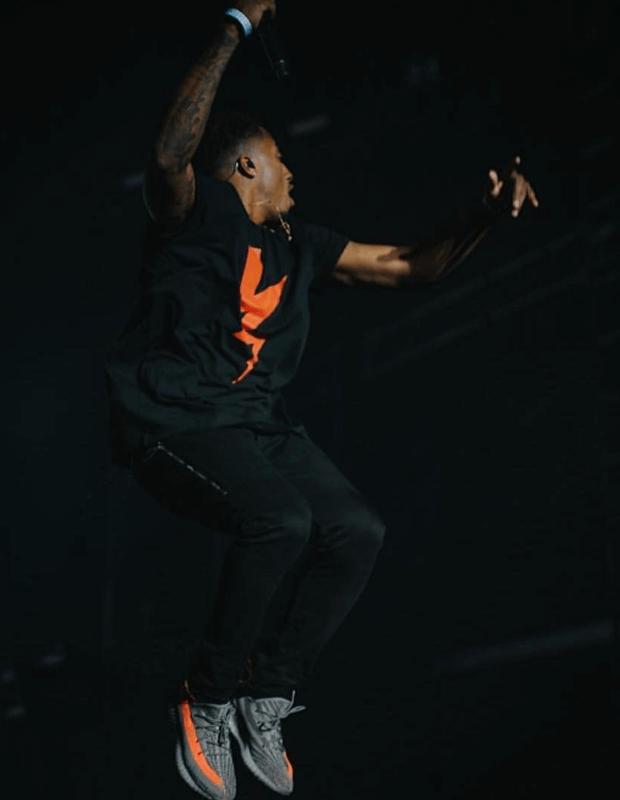 Lecrae in the adidas Yeezy Boost 350 V2 Beluga/Solar Red