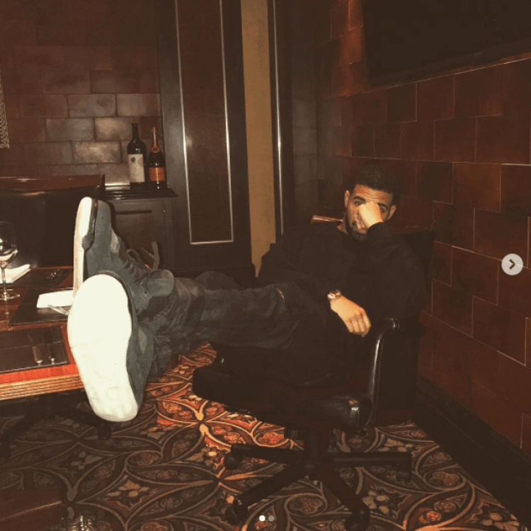 Drake in the Kaws x Air Jordan 4