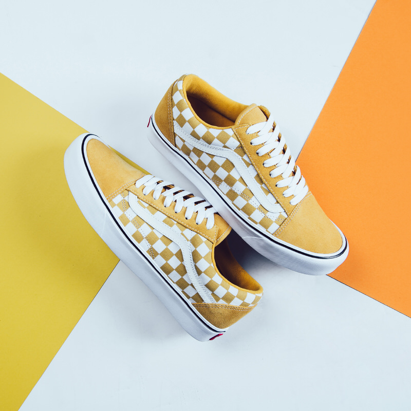 checkerboard old skool vans with yellow detail
