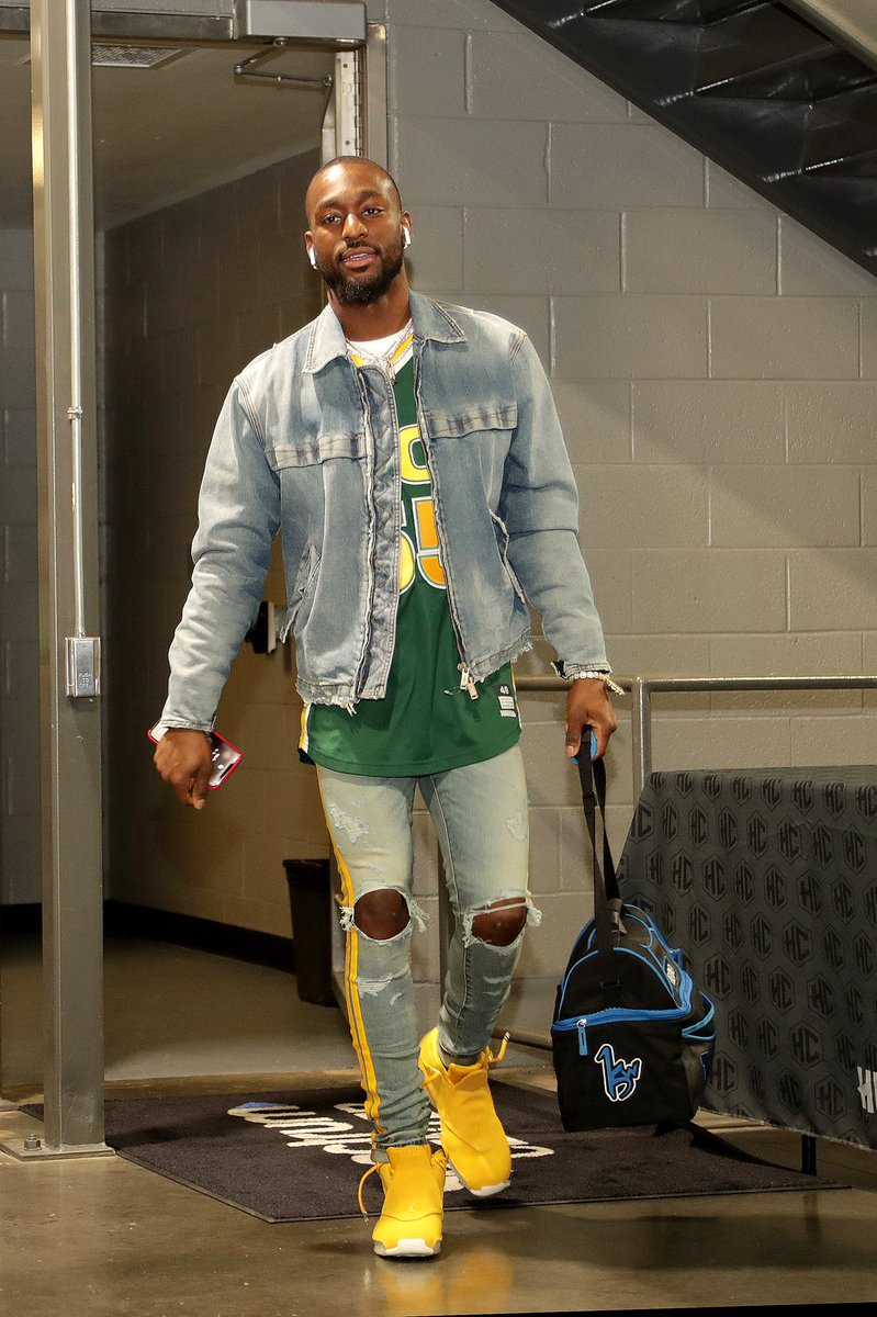 Kemba Walker in the Air Jordan 18 Retro 'Yellow Ochre""
