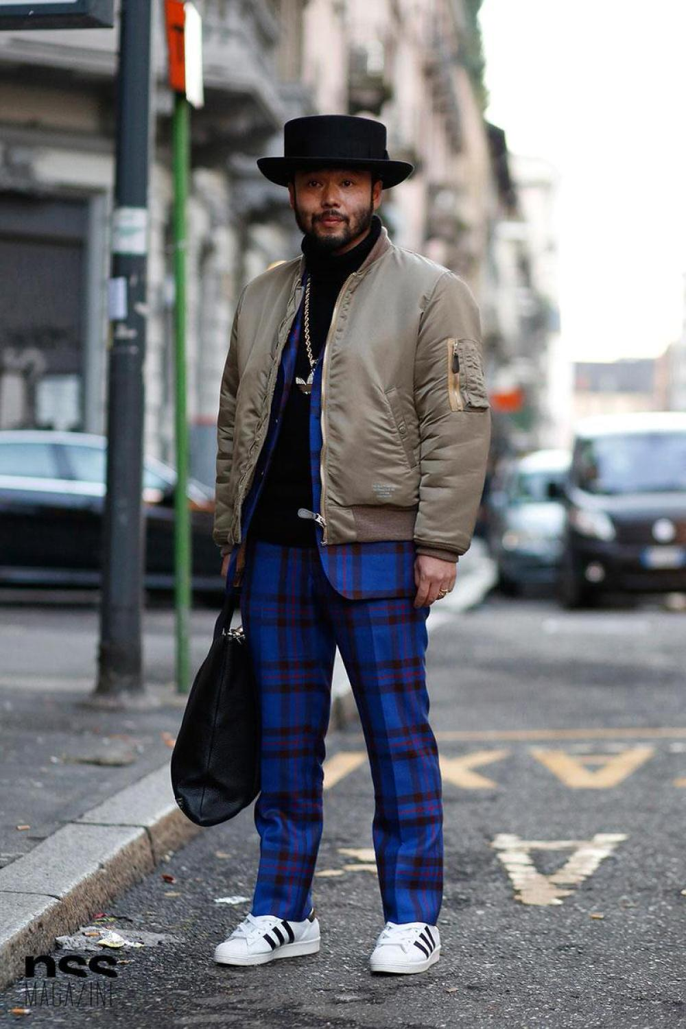 A neutral bomber jacket and a classic pair of Superstars really offset the look of a vibrant pair of plaid pants.