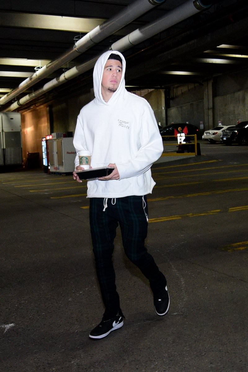 Devin Booker keeps his look minimal with the Supreme x CDG x Nike Air Force 1 Low.