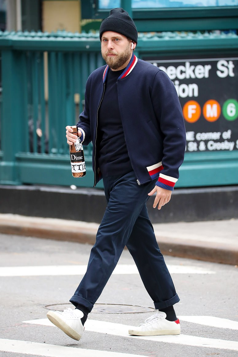 Jonah Hill's Gucci bomber and Saint Laurent SL/06 combination is an effective combo that blends designer with a skate punk edge.
