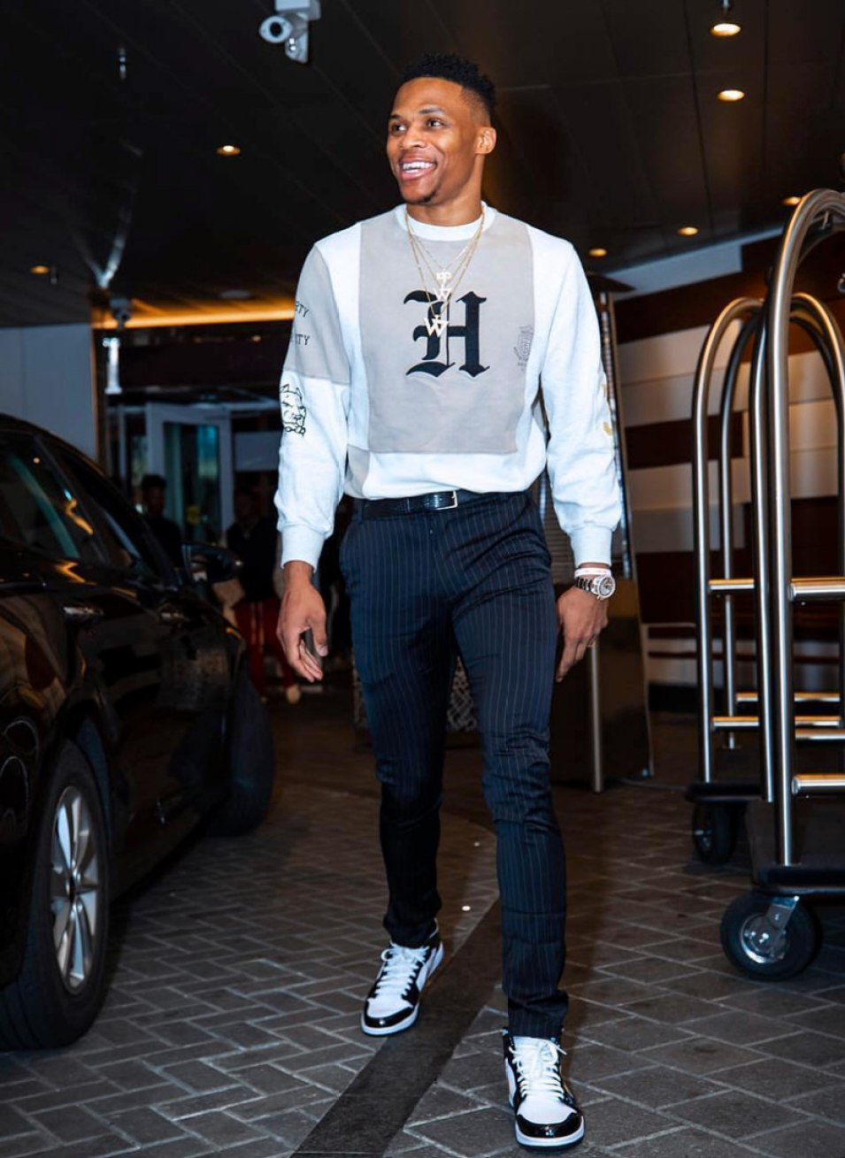 bfd89c15aba7 Russell Westbrook in the Air Jordan 1 Mid White-Black-Gold ...