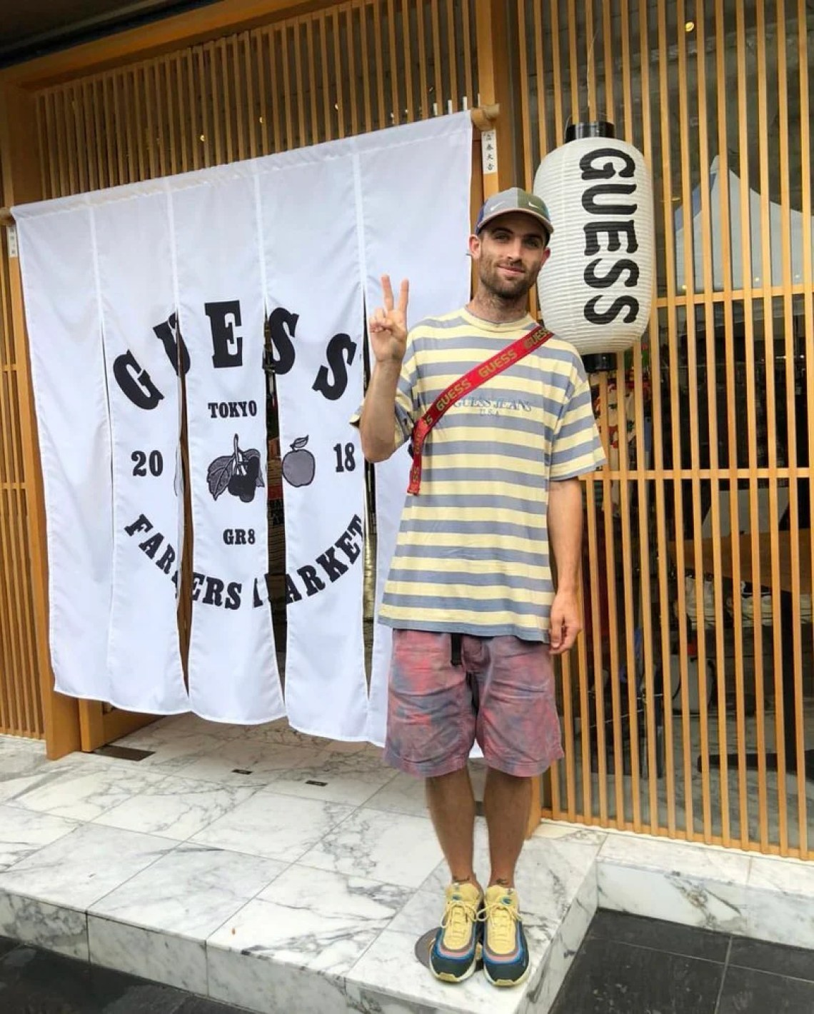 Tie-Dye shorts are just about the easiest way to wear the incoming tie-dye trend. Sean shows you that they go great with striped GUESS shirts and his Air Max 1/97s.