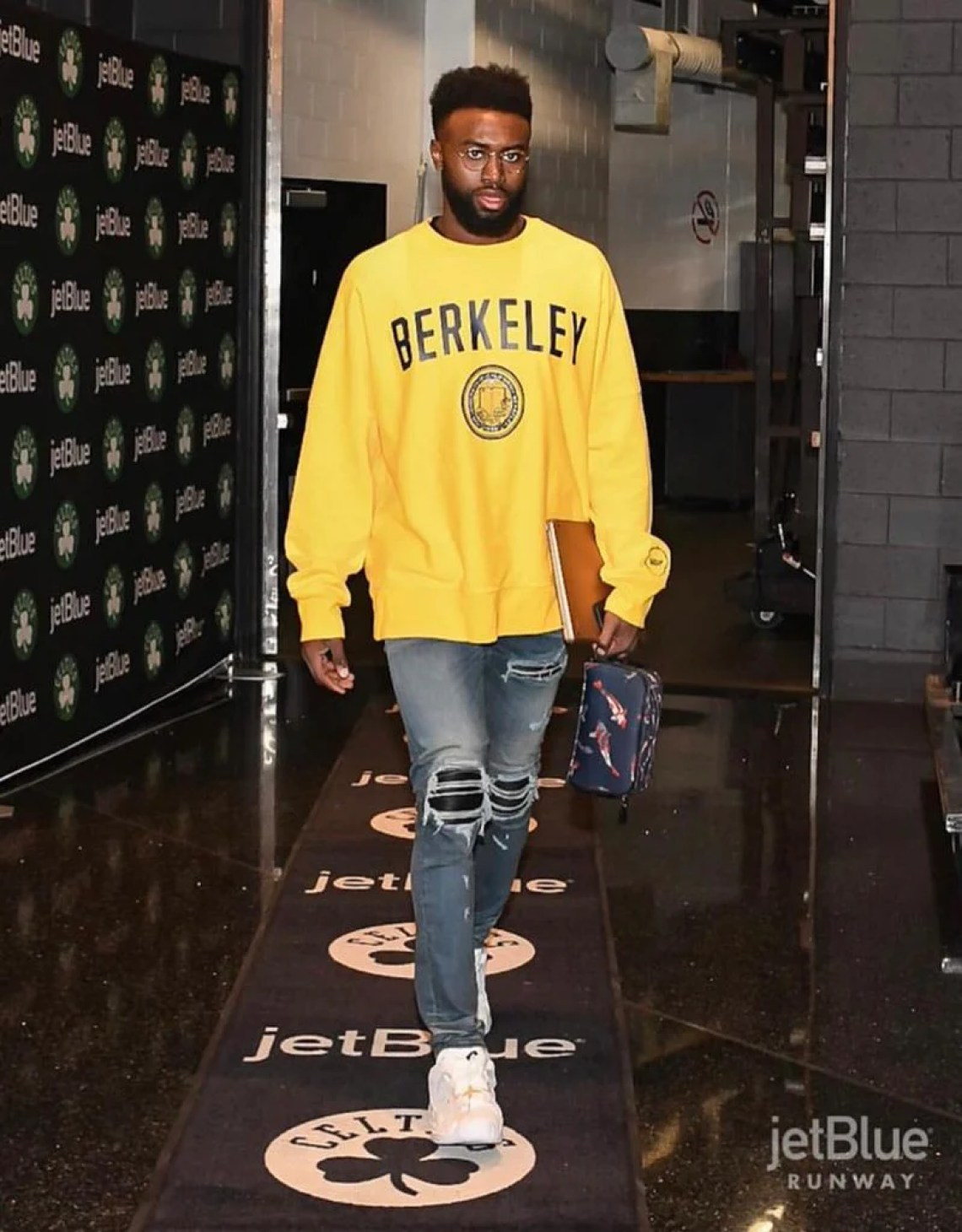 Jaylen Brown with the retro Berkeley crewneck and AMIRI MX1 Leather Patch jeans.