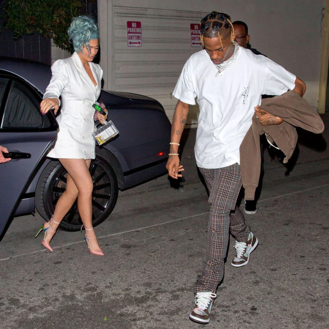 Kylie Jenner with Travis Scott, wearing the FLOM (For Love or Money) SB Dunk Highs.