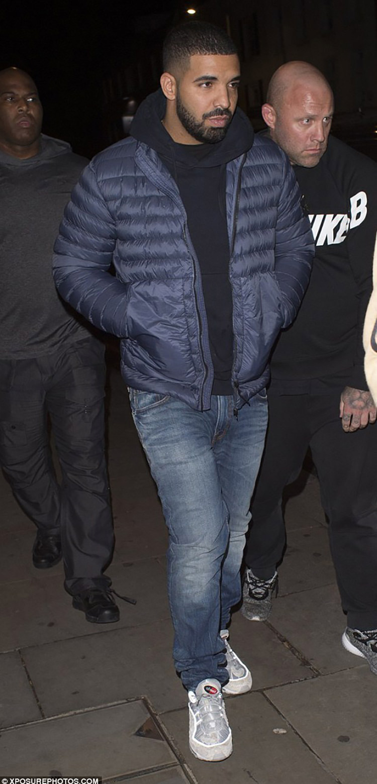 Drake gears up for the cold in a Stone Island down jacket and the Supreme x Nike Air Max 98.
