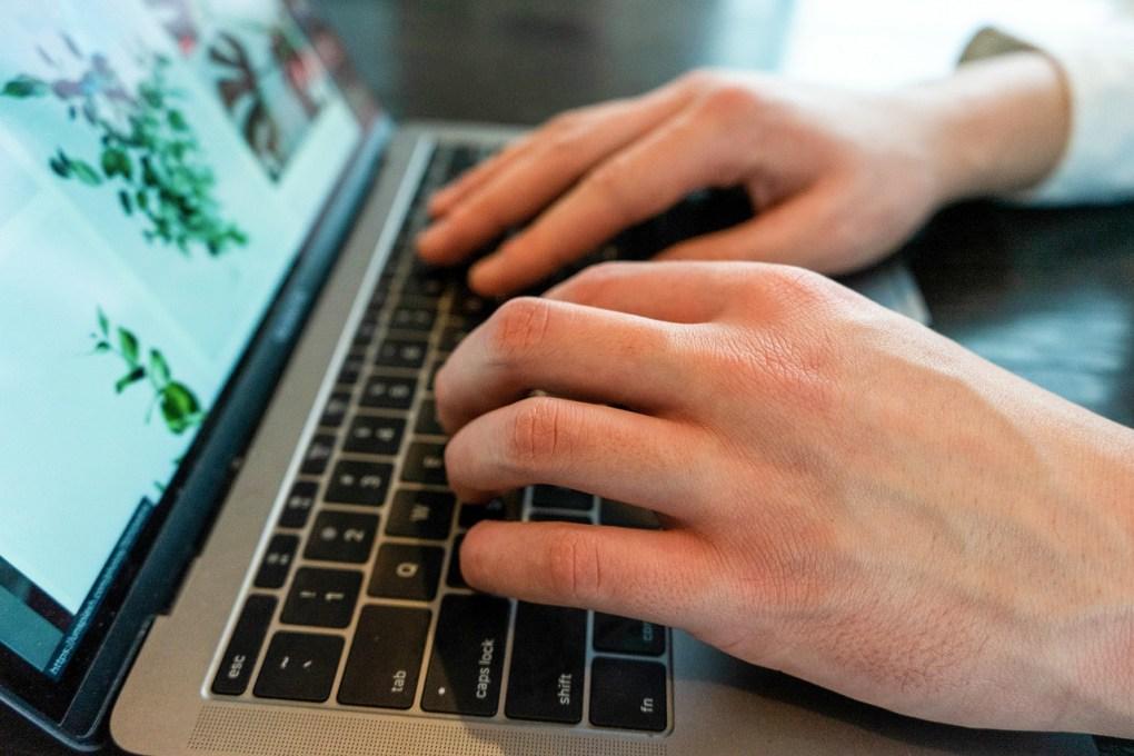 Typing at laptop