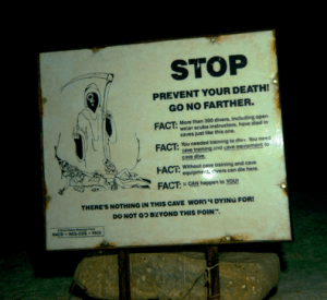 Stop Prevent Your Death Sign in Cenote