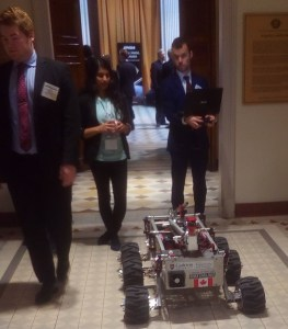 """Carleton University students with their rover """"Sparky"""""""