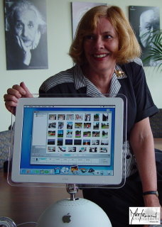 Susan with iMac showing iPhoto
