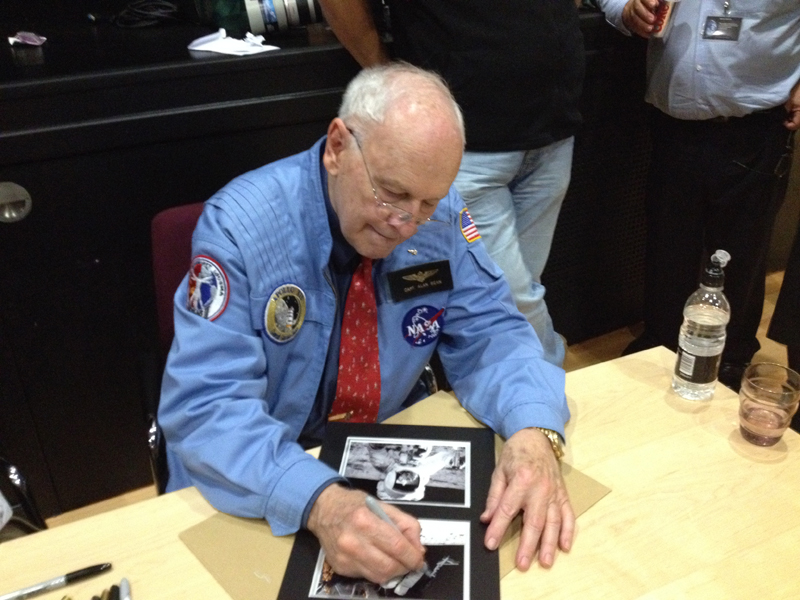 Alan Bean signing his autograph on my photo