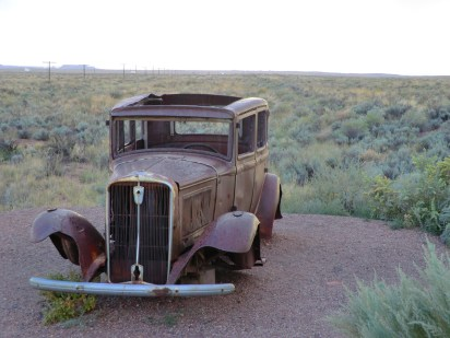 Abandoned car at the Painted Desert at the site of the old route 66 parallel to Interstate 40