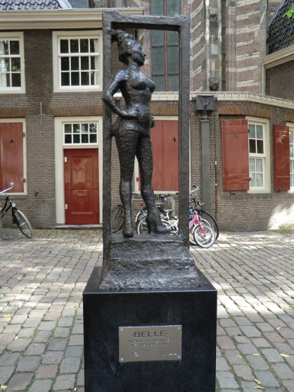 "The Belle statue on the Oudekerksplein. The plaque reads ""Respect sex workers all over the world."""