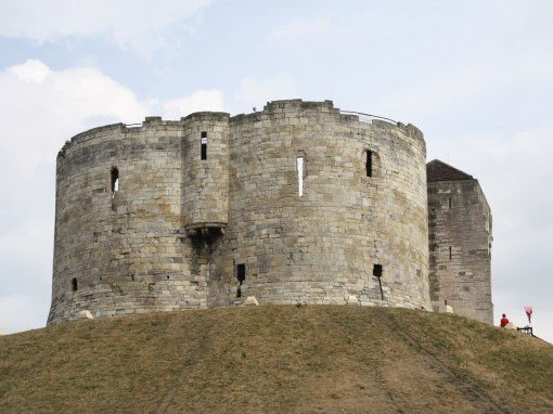 Clifford's Tower. The original motte and bailey castle on this site was erected by William The Conqueror. The present Great Tower was built between 1245 and 1262 by order of King Henry III.