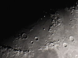 Sinus Lunicus on Mare Imbrium with rugged mountain range of Montes Apenninus.