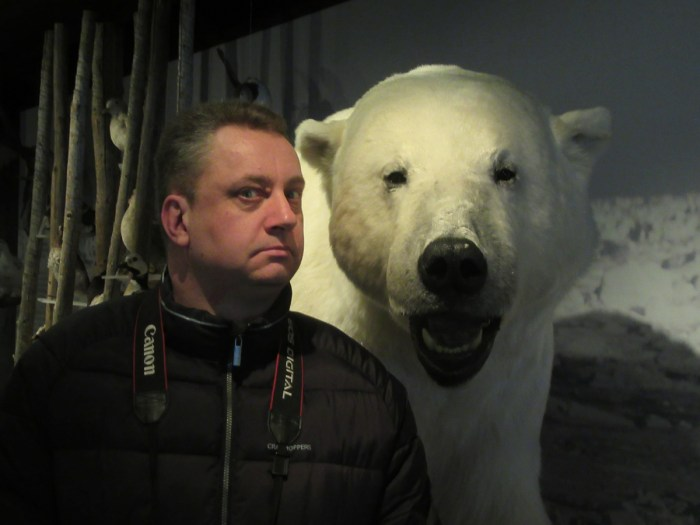 There's a Polar Bear behind me isn't there? Hammerfest Tourist Information Office / Polar Bear Society.