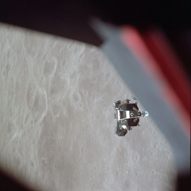 "The ascent stage of the Apollo 10 Lunar Module ""Snoopy"" photographed from the Command Module ""Charlie Brown"" prior to docking in lunar orbit."