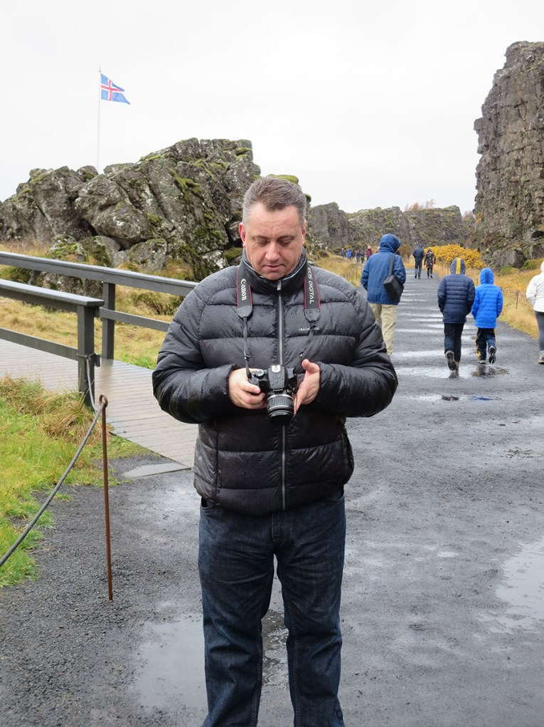 Examining a rain soaked DSLR at the Thingvellir Icelandic Parliament