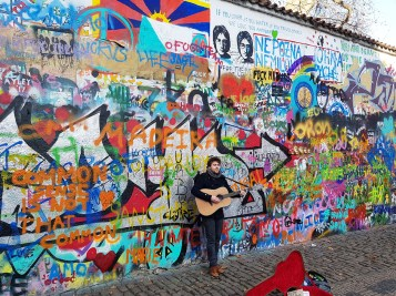 The Lennon Wall. Yes, some w*nker with a guitar will rock up and play The Beatles