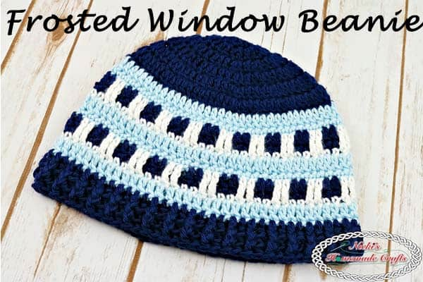 Frosted Window Beanie reflects light blue, dark blue and white to demonstrate city windows that are frosted in during the winter time- Free Crochet Pattern by Nicki's Homemade Crafts #crochet #frosted #frosty #window #beanie #hat #blue #head