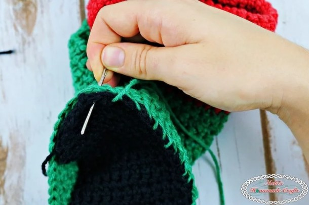 Sewing the sole to the booties for the Adult Christmas Santa and Elf Booties - Free Crochet Pattern