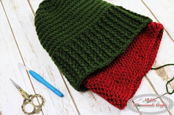 Two beanies sewn up together to create one warm and cozy textured slouchy beanie with many option on how to wear it. It is green or red with horizontal and vertical lines showing its texture.