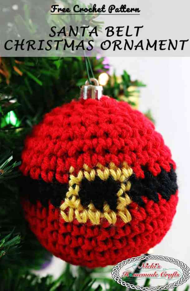 Santa Belt Christmas Ornament - closeup of the Santa ornament with the belt buckle being gold and the belt being black hanging on the christmas tree - Free Crochet Pattern by Nicki's Homemade Crafts #crochet #ornament #christmas #winter #tree #free #crochet #pattern #belt