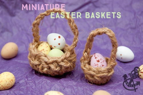 Miniature brown easter baskets with very tiny eggs displayed on a purple cloth surface
