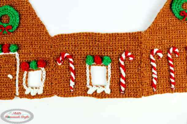 Side panel of Gingerbread House with candy