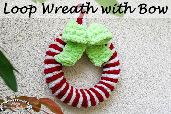 red and white Loop Wreath with green bow