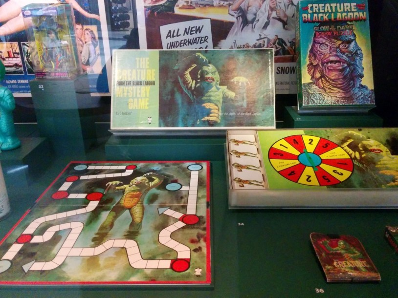 the Creature from the Black Lagoon collection: Mystery Game, 1963; glow-in-the-dark jigsaw puzzle, 1974; creature wallet, 1963