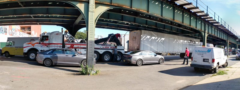 when your truck container gets clipped on 31st Street, you call in this big guy to tow it away!
