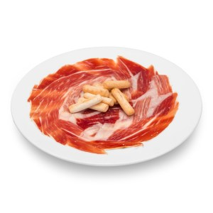 Hand-cutting of ham and packaging in sachets
