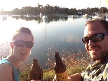 Matt an I having drinks by the river at Calypso Holiday Park, Yamba, Australia