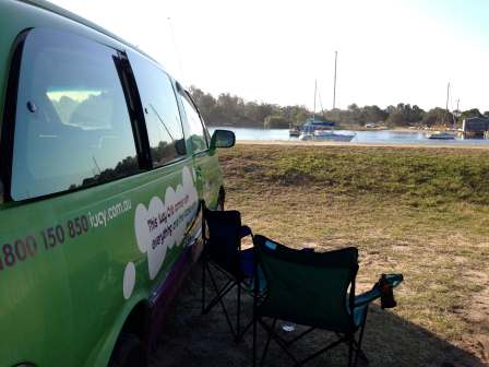 The campervan parked up with a beautiful view of the river at Calypso Holiday Park, Yamba, Australia