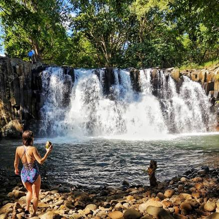 Admiring Rochester Falls with fresh coconut water