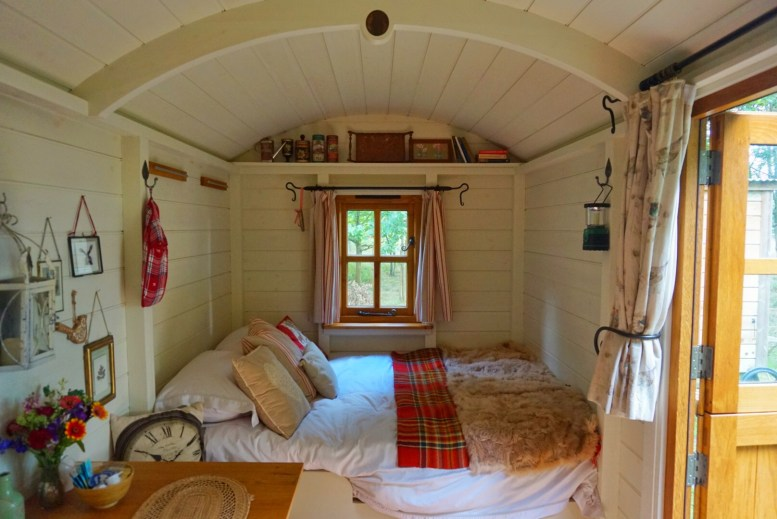 The cosy double bed in the shepherd's hut at Warmwell House in Dorset.