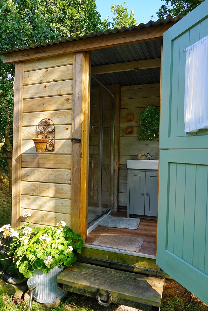 The bathroom hut at Sika shepherd's hut at Warmwell House in Dorset.