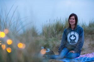 An image of me sitting in the sand dunes at Camber Sands