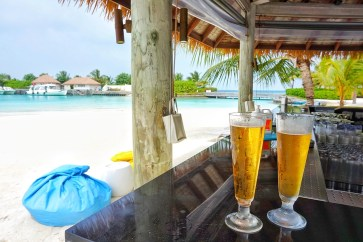 Beer with a beach view in the Maldives.