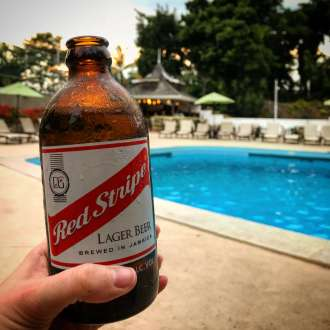 Having a Red Stripe beer while the sunsets in Kingston, Jamaica.