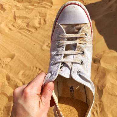 My shoe full of sand after sand boarding in Dubai.