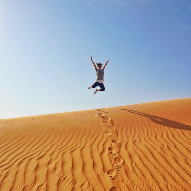 Me, mid air jump on top of a sand dune in Dubai Desert Conservation Reserve