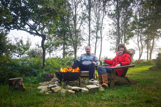 Matt and I sat by the firepit on our glamping trip in Dorset.