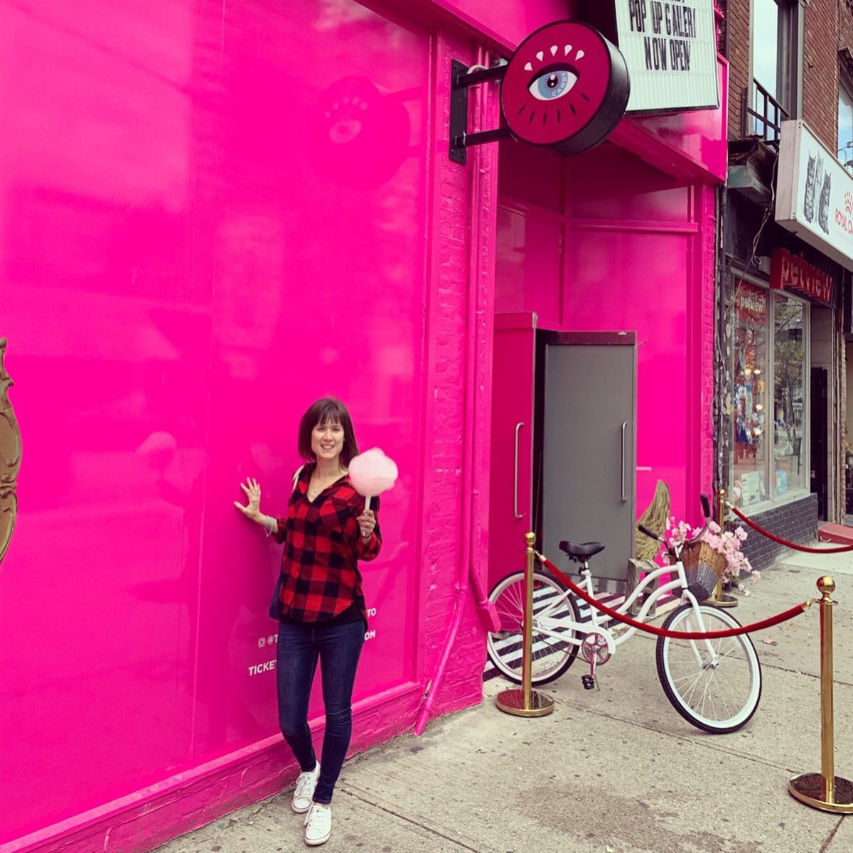 Me outside Eye Candy in Toronto with candy floss.