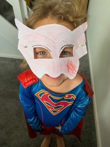 Emily wearing her homemade Owlette mask
