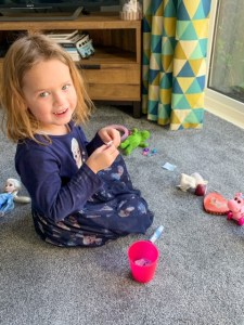 Emily playing the Five Minute Mum toy tombola game
